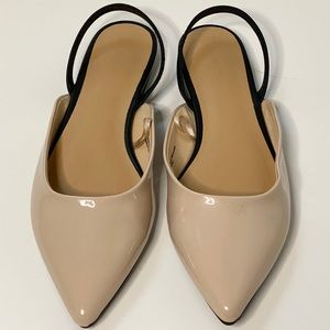 Express nude and black flats